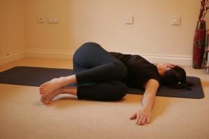 Supine Twist Yoga Pose