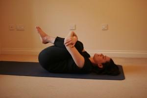 Double Knee Hug Yoga Pose