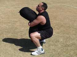 sandbag bear hug squat