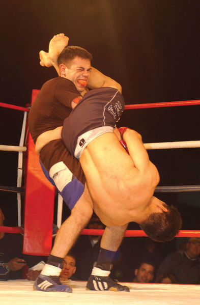 MMA cage fighters throwing