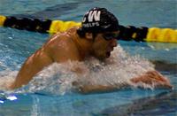 swimmer in pool doing butterfly
