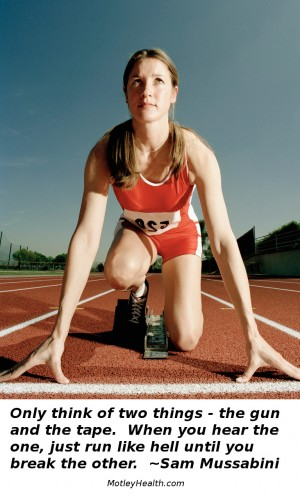 female sprinter on the blocks