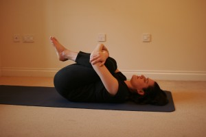 Apanasana - Knee Hug Yoga Pose
