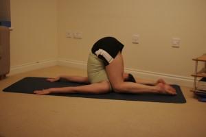 Karnapidasana - Ear Pressure Yoga Pose