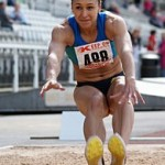 Jessica Ennis doing the long jump