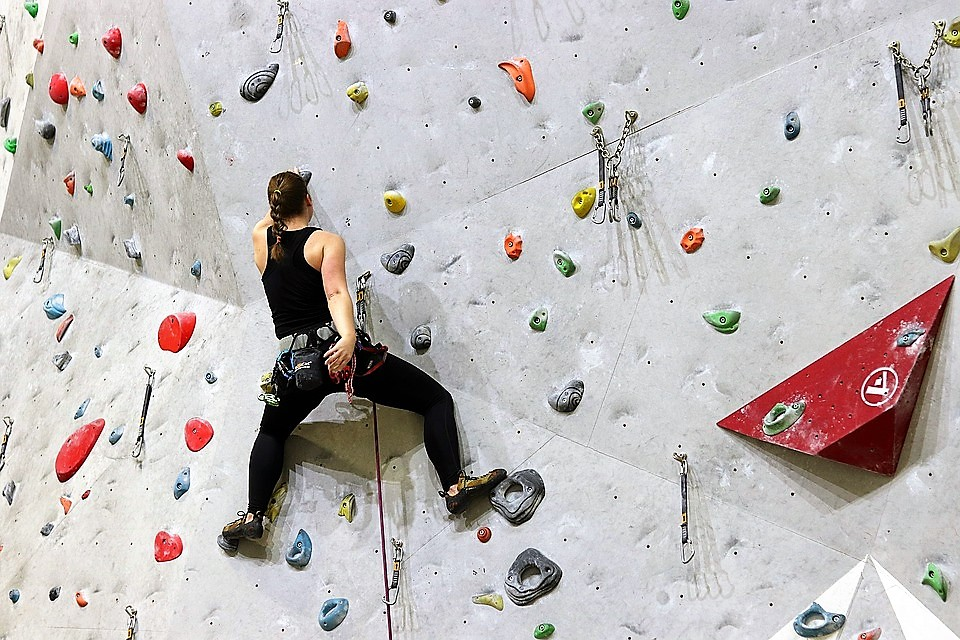 woman training on a rock climbing wall