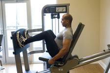 over 50 weight trainer performing a leg presses