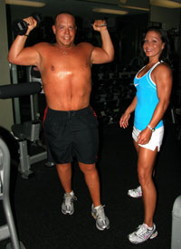 Pete Ajello lifting weights with Kari Williams