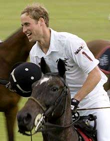 Prince William riding a horse in a polo match