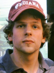 Jesse Eisenberg wearing a red cap