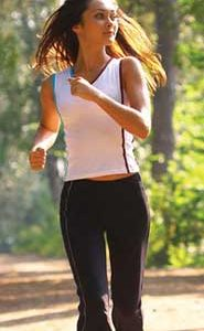 Young woman jogging through the park