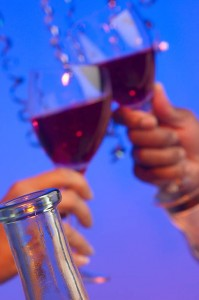 Two wine glasses at a party