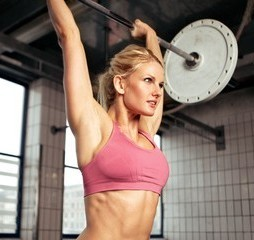 Woman doing shoulder press exercise