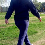 a woman walking in a park