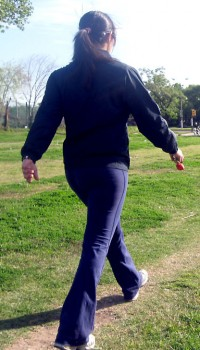 a woman walking in a park