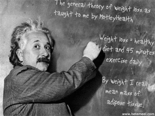 Einstein writing on a chalk board