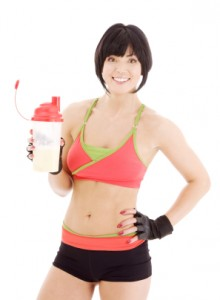 Fitness instructor holding a protein shake