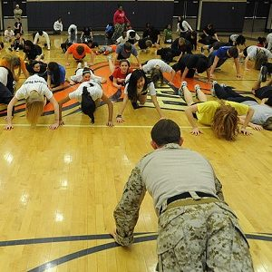 US Navy take school fitness class