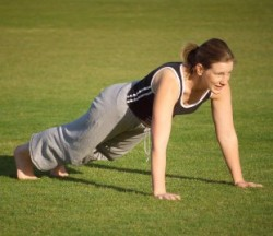 Woman doing push ups in park