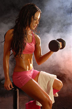 Fitness Model Britt 2007 performing dumbbell curl
