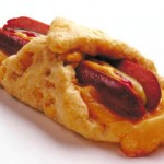 Processed sausage wrapped in pastry and cheese