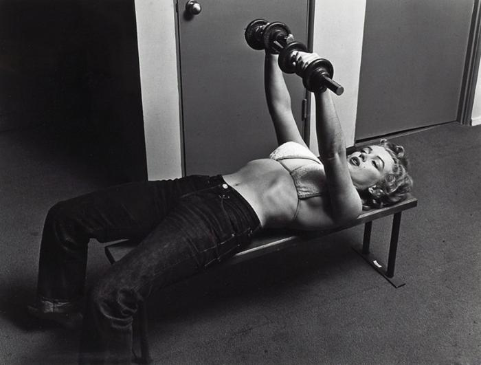 Marylin Monroe weight training on a bench