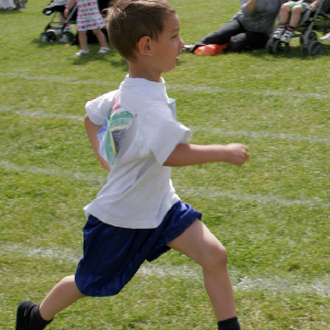 Young boy running in school sports day
