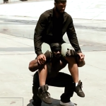 Kali squatting with man on soulders