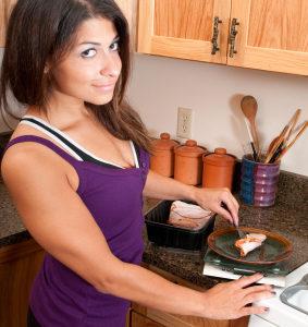Athletic woman preparing food