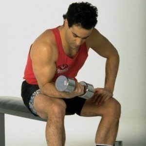 Less is more. Man doing seated bicep curls