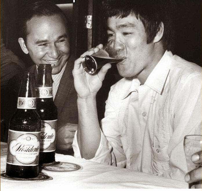 Bruce Lee drinking a beer