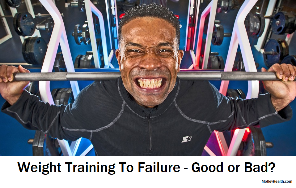 man weight training squatting to failure