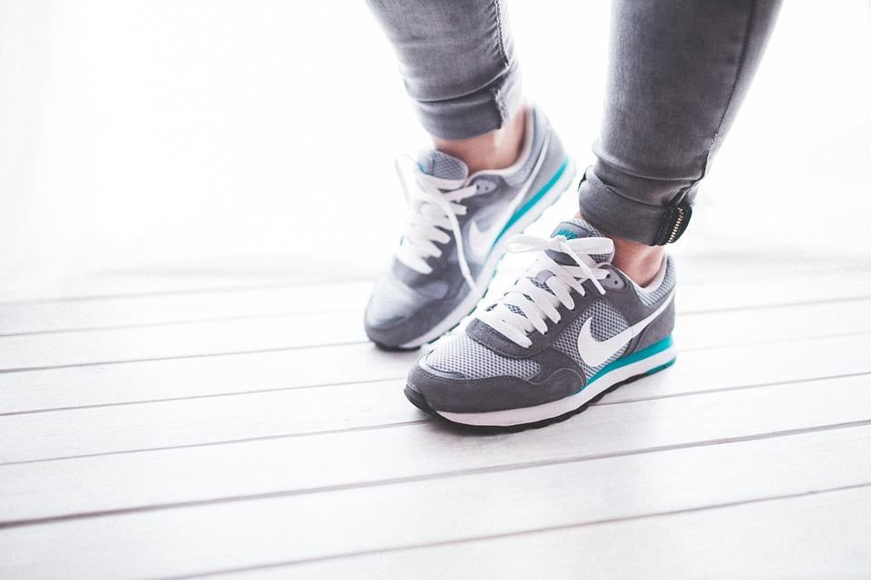 close up of woman wearing Nike shoes