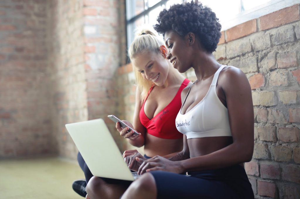 two women planning their fitness and health