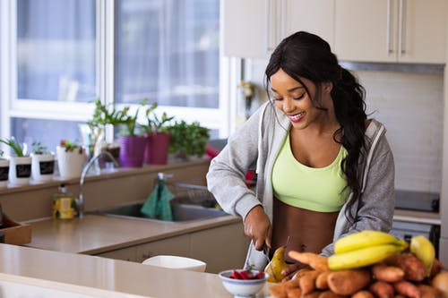 woman preparing a healthy meal in a kitchen