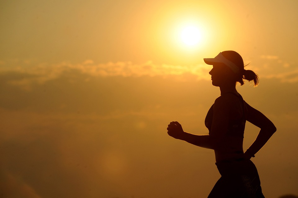 woman running at sunrise