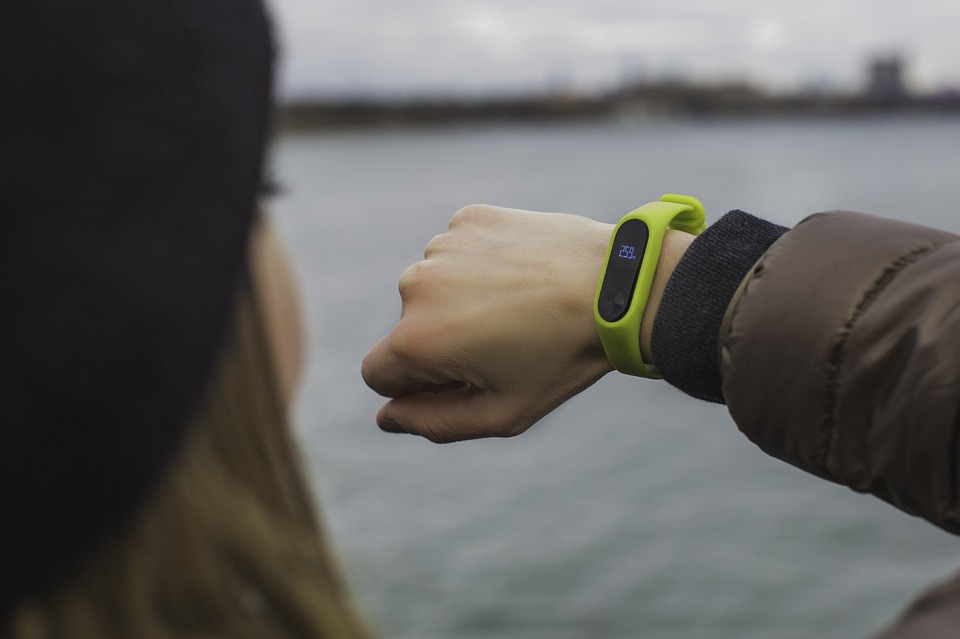 woman using a wrist fitness tracker