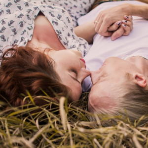 couple laying in the straw