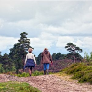 two people walking in the countryside