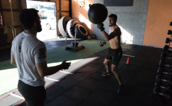 men exercising in Crossfit gym