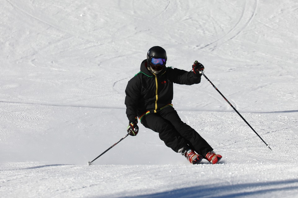 man skiing wearing all black