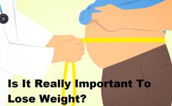 doctor measuring patients waist