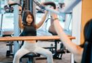 woman working out on weight training machine