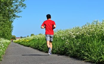 man running outside in summer surrounded by flowers