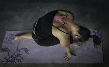 woman doing yoga on an old yoga mat