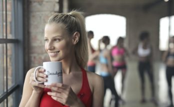 woman fitness club owner in red