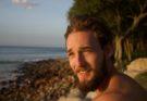 man on beach with good hair