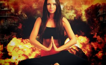 woman meditating with inferno behind
