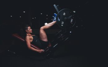 woman doing leg presses in a gym