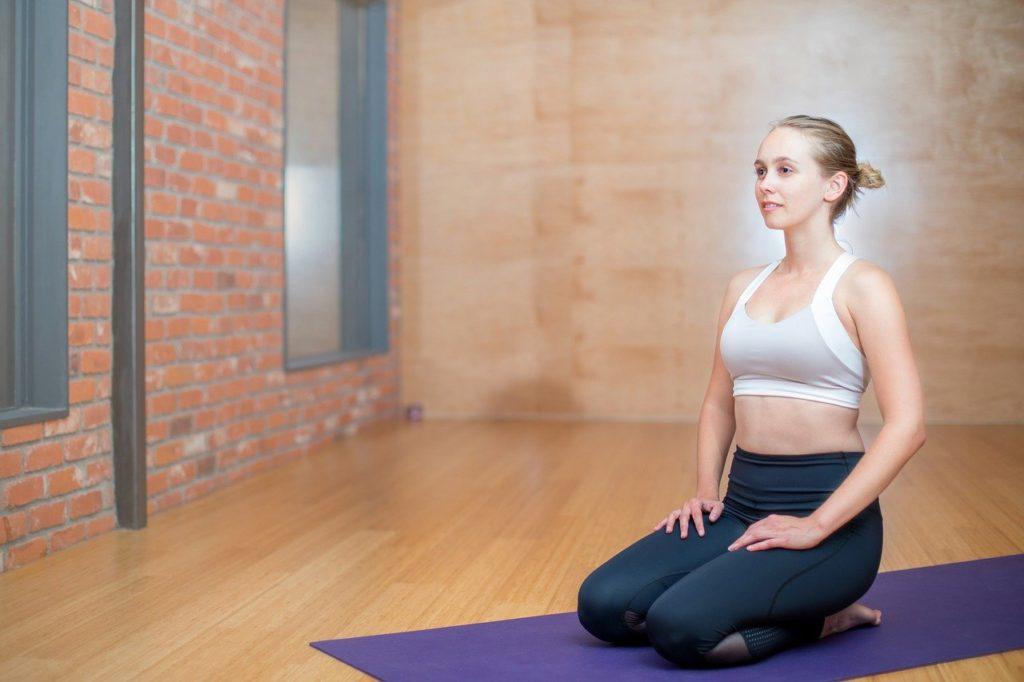 woman kneeling with good posture